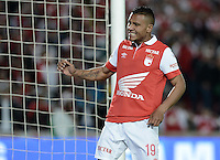 BOGOTÁ -COLOMBIA, 29-11-2014. Wilson Morelo jugador de Santa Fe en acción durante el encuentro entre Independiente Santa Fe y Atlético Huila por la fecha 4 de los cuadrangulares finales de la Liga Postobón II 2014 jugado en el estadio Nemesio Camacho El Campín de la ciudad de Bogotá./ Wilson Morelo player of Santa Fe in action during the match between Independiente Santa Fe and Atletico Huila for the 4th date of the final quadrangular of the Postobon League II 2014 played at Nemesio Camacho El Campin stadium in Bogotá city. Photo: VizzorImage/ Gabriel Aponte / Staff