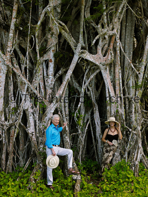 Jill and David Gilmour photographed against the roots of a giant mangrove tree