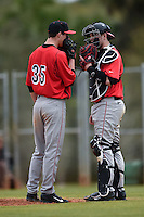 Illinois State Redbirds pitcher Jacob Hendren (35) talks with catcher Blake Molitor (42) during a game against the Georgetown Hoyas on March 7, 2015 at North Charlotte Regional Park in Port Charlotte, Florida.  Illinois State defeated Georgetown 2-1.  (Mike Janes/Four Seam Images)