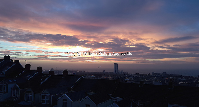 WEATHER PICTURE WALES<br /> Pictured: A dramatic sky is formed during sunrise over Swansea Bay in Wales, UK. Friday 16 December 2016