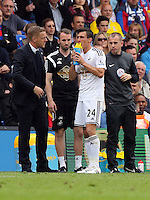 Pictured: Swansea manager Garry Monk (L) gives instructions to Jack Cork<br />