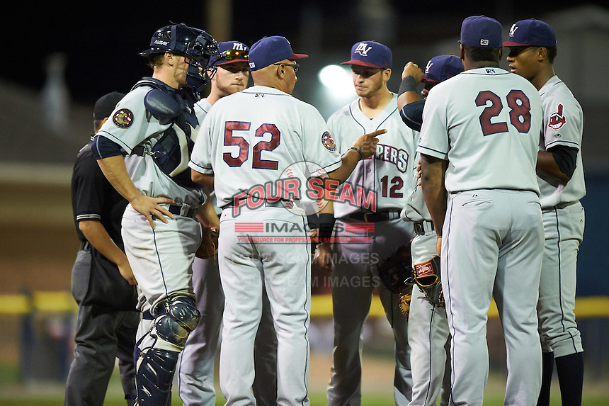Mahoning Valley Scrappers manager Edwin Rodriguez (52) talks with pitcher Luis Jimenez (right) as catcher Jack Goihl (53), Gavin Collins (44), Alexis Pantoja (12), Erlin Cerda (4), and Emmanuel Tapia (28) listen during a game against the Batavia Muckdogs on August 18, 2016 at Dwyer Stadium in Batavia, New York.  Batavia defeated Mahoning Valley 2-1.  (Mike Janes/Four Seam Images)