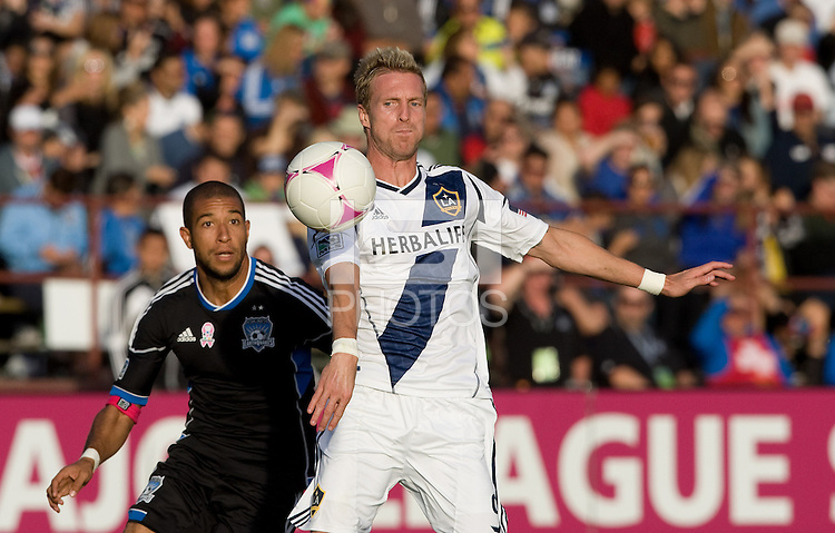Christian Wilhelmsson of Galaxy controls the ball in the air away from Justin Morrow of Earthquakes during the game at Buck Shaw Stadium in Santa Clara, California on October 21st, 2012.  San Jose Earthquakes and Los Angeles Galaxy tied at 2-2.