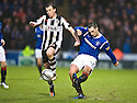 RANGERS' LEE WALLACE PUTS IN A CROSS AS ST MIRREN'S PAUL MCGOWAN PUTS IN A CHALLENGE