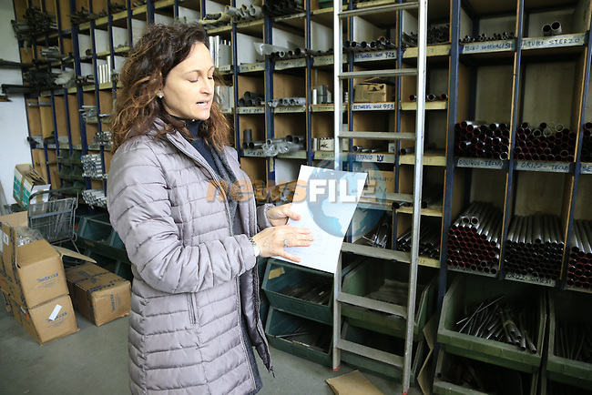Barbara holds a custom sizing chart to be made up to specification for a client at the Tommasini factory based in Grosseto, Tuscany, Italy 6th March 2017.<br /> Picture: Eoin Clarke | Newsfile<br /> <br /> <br /> All photos usage must carry mandatory copyright credit (&copy; Newsfile | Eoin Clarke)