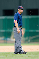 Umpire Ryan Clark handles the calls on the base paths during a Gulf Coast League game between the GCL Phillies and the GCL Braves at Disney's Wide World of Sports Complex, July 13, 2009, in Orlando, Florida.  (Photo by Brian Westerholt / Four Seam Images)