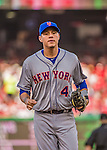 6 April 2015: New York Mets infielder Wilmer Flores trots back to the dugout during the Season Opening Game against the Washington Nationals at Nationals Park in Washington, DC. The Mets rallied to defeat the Nationals 3-1 in their first meeting of the 2015 MLB season. Mandatory Credit: Ed Wolfstein Photo *** RAW (NEF) Image File Available ***