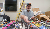 NWA Democrat-Gazette/BEN GOFF @NWABENGOFF<br /> Rick Marshall of Springdale, president of the Sugar Creek Astronomical Society, sorts solar viewing glasses Saturday, Jan. 12, 2019, at Explore Scientific in Springdale. Many people in the United States purchased solar viewing glasses for the August 2017 solar eclipse. Explore Scientific has been collecting donated solar eclipse glasses on behalf of Astronomers Without Borders and volunteers from NWA Space are inspecting and sorting them. Astronomers Without Borders, a U.S.-based organization that promotes bringing people together through astronomy in developing countries, plans to distribute the glasses to schools in South America and Asia where eclipses will be visible this year, according to the organization's website.