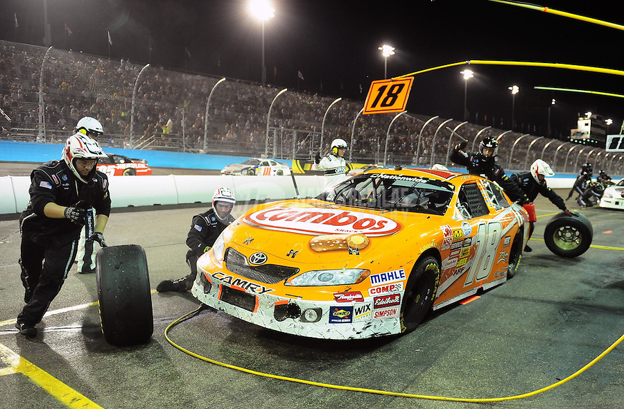 Apr 9, 2010; Avondale, AZ, USA; NASCAR Nationwide Series driver Kyle Busch pits during the Bashas Supermarkets 200 at Phoenix International Raceway. Mandatory Credit: Mark J. Rebilas-