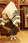 IIsrael, Bnei Brak. The Synagogue of the Premishlan congregation on Purim holiday, the Priest with his shoes off is covering his head with the Talith during the Priestly Blessing prayer, 2005<br />