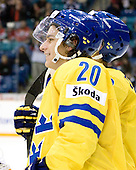 Andre Petersson (Sweden - 20) - Team Sweden celebrates after defeating Team Switzerland 11-4 to win the bronze medal in the 2010 World Juniors tournament on Tuesday, January 5, 2010, at the Credit Union Centre in Saskatoon, Saskatchewan.