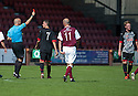 Pars' Christopher Kane (far right) is sent off.