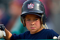 A young bat girl during the game between AABC and Babe Ruth at the 2011 Tournament of Stars at the USA Baseball National Training Center on June 26, 2011 in Cary, North Carolina.  Babe Ruth defeated AABC 3-2 in the Gold Medal game. (Brian Westerholt/Four Seam Images)