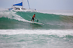 Paddleboard surfing in head high waves at Ka'anapali Point on Maui, HI