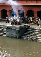 Sunset cremation of body next to the holy Baymati River in Kathmandu Nepal Katmandu