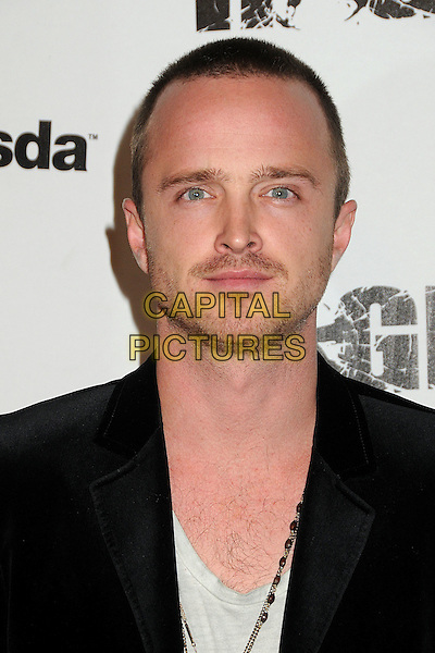 "Aaron Paul.""Rage"" Video Game Launch Party held in Chinatown's Historical Central Plaza, Los Angeles, California, .30th September 2011..portrait headshot  stubble facial hair black jacket .CAP/ADM/BP.©Byron Purvis/AdMedia/Capital Pictures."
