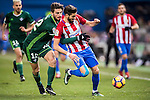 Yannick Ferreira Carrasco (r) of Atletico de Madrid battles for the ball with Cristiano Piccini of Real Betis Balompie during their La Liga 2016-17 match between Atletico de Madrid vs Real Betis Balompie at the Vicente Calderon Stadium on 14 January 2017 in Madrid, Spain. Photo by Diego Gonzalez Souto / Power Sport Images