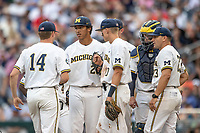 Michigan Wolverines pitcher Isaiah Paige (25) waits on the mound against the Vanderbilt Commodores during Game 2 of the NCAA College World Series Finals on June 25, 2019 at TD Ameritrade Park in Omaha, Nebraska. Vanderbilt defeated Michigan 4-1. (Andrew Woolley/Four Seam Images)