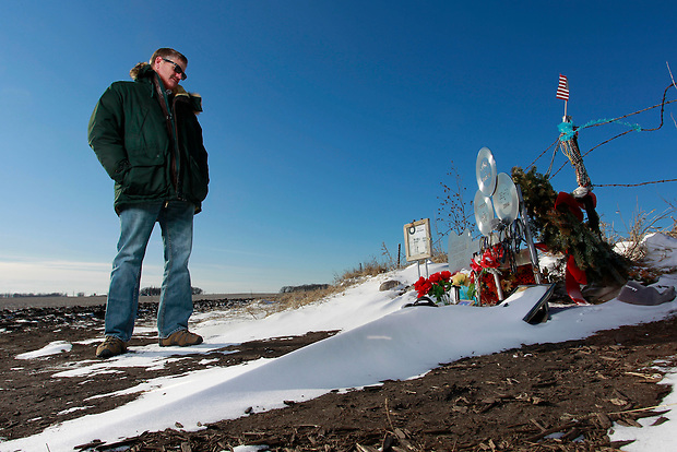 "1/19/12 3:28:10 PM -- Clear Lake, IA, U.S.A. -- THIS IS FOR A LIFE COVER:.Jeff Nicholas, president of the Surf Ballroom & Museum stands near a memorial at the site of the 1959 plane crash that killed  Buddy Holly, Ritchie Valens and J.P. ""The Big Bopper"" Richardson a few miles outside of Clear Lake, Iowa.  Nicholas also owns the land.  ""It's an honor to own this land.  People come from all over the world to stand at this site.  This is where the music died, but in a way, it's also where the music began,"" he says..On Feb. 3, 1959, Buddy Holly, Ritchie Valens and the Big Bopper died when their plane crashed in a farm field north of Clear Lake, Iowa ? an event memorialized as ?the day the music died? in the 1971 song American Pie by Don McLean. The three 1950s stars played their last gigs at Clear Lake?s Surf Ballroom, which is intact today and holds an annual celebration of its moment in music history. The ballroom, largely the same as it was in its ?50s heyday, struggled as a for-profit business and has been operated as a non-profit since 2008. It hosts concerts, weddings, reunions and school tours. It has a small museum, but the big draw is the place itself. The maple dance floor and booths are original. One of the two original coat checks is still there and so is the phone that Holly used to call his wife before the fatal crash, the website boasts. The fun part is the annual gathering of fans from all over the world, which this year is Feb. 1-4 and is delicately called the ?winter dance party.? There are concerts each night, a bus outing to the crash site, which is marked by a giant pair of the glasses Holly wore, dance lessons, video and art contests and a gathering of the British Buddy Holly Society (whose members have been coming to Clear Lake for 23 years). Chuck Berry is a featured performer this year. It?s a charming and weird slice of Iowa life and rock ?n? roll history. -- ...Photo by Christopher Gannon for USA TODAY."