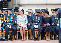 Prince William, Catherine Duchess of Cambridge, Prince Harry, Meghan Duchess of SussexThe Royal Family watch RAF centenary fly-past at Buckingham Palace, The Mall, London, England on July 10, 2018.<br /> CAP/GOL<br /> &copy;GOL/Capital Pictures