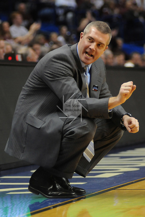 March 5,  2011       Indiana State Sycamores head coach Greg Lansing yells over to his bench players late in the second half.  Indiana State defeated MIssouri State 60-56 in the championship game of the NCAA Missouri Valley Conference Men's Basketball Tournament on Sunday March 6, 2011 at the Scottrade Center in downtown St. Louis.  They received an automatic bid to the NCAA Basketball Tournament