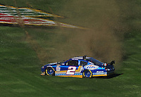 Nov. 1, 2009; Talladega, AL, USA; NASCAR Sprint Cup Series driver Kurt Busch spins during the Amp Energy 500 at the Talladega Superspeedway. Mandatory Credit: Mark J. Rebilas-