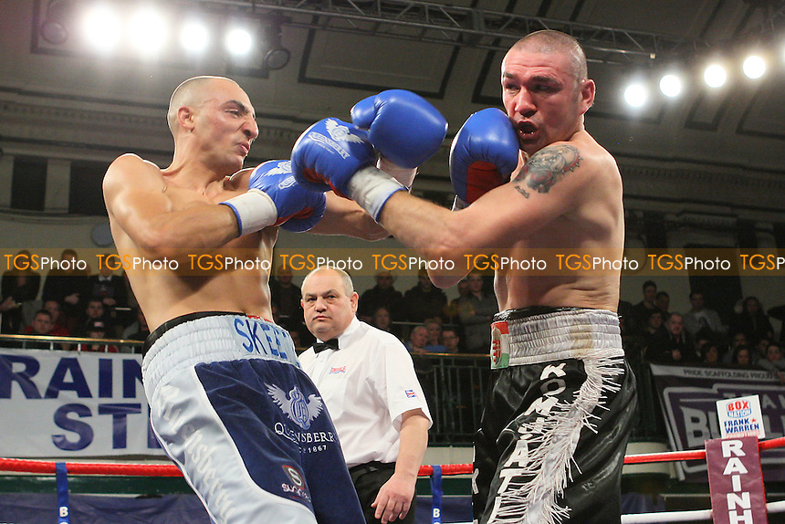 Bradley Skeete (blue shorts) defeats Laszlo Komjathi in a Welterweight boxing contest at York Hall, Bethnal Green, promoted by Frank Warren - 10/02/12 - MANDATORY CREDIT: Gavin Ellis/TGSPHOTO - Self billing applies where appropriate - 0845 094 6026 - contact@tgsphoto.co.uk - NO UNPAID USE.