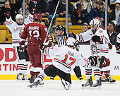 Wade MacLeod (Northeastern - 19), Steve Silva (Northeastern - 17), and Tyler McNeely (Northeastern - 94) celebrate Silva's goal which made it 3-0. - The Northeastern University Huskies defeated the Harvard University Crimson 4-0 in their Beanpot opener on Monday, February 7, 2011, at TD Garden in Boston, Massachusetts.