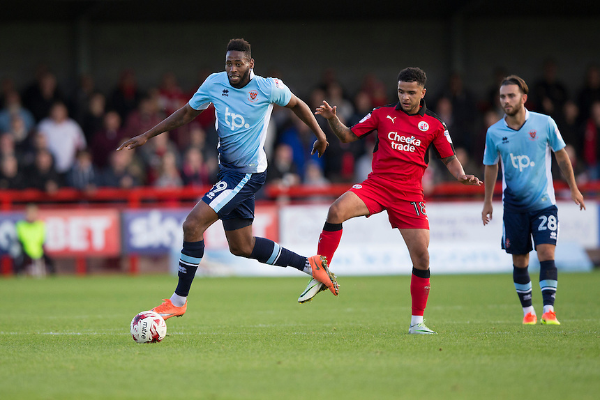 Blackpool's Jamille Matt holds off the challenge from Crawley Town's Billy Clifford<br /> <br /> Photographer Craig Mercer/CameraSport<br /> <br /> The EFL Sky Bet League Two - Crawley Town v Blackpool - Saturday 1st October 2016 - Broadfield Stadium - Crawley<br /> <br /> World Copyright &copy; 2016 CameraSport. All rights reserved. 43 Linden Ave. Countesthorpe. Leicester. England. LE8 5PG - Tel: +44 (0) 116 277 4147 - admin@camerasport.com - www.camerasport.com