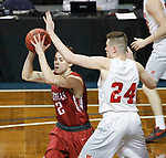 SIOUX FALLS, SD - MARCH 9:  Jordon Knoebel #12 of IU Southeast looks past the defense of Kyle Mangas #24 if Indiana Wesleyan at the 2018 NAIA DII Men's Basketball Championship at the Sanford Pentagon in Sioux Falls. (Photo by Dick Carlson/Inertia)