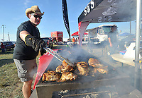 NWA Democrat-Gazette/MICHAEL WOODS • @NWAMICHAELW<br /> Ethan Korpella with Sons of Sauce, prepares a batch of chicken for the barbecue contest Friday September 25, 2015 at the Washington County Fairgrounds in Fayetteville. The 16th annual Bikes, Blues and BBQ Motorcycle Rally runs through Saturday on Dickson Street, Baum Stadium and the Washington County Fairgrounds in Fayetteville and all day Saturday at Arvest Ballpark in Springdale.
