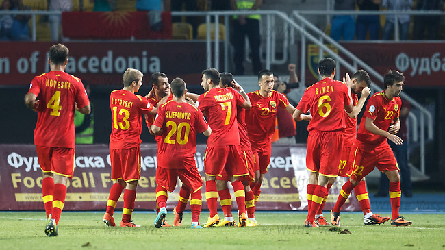 The Macedonians celebrate after scoring thinking they have won a share of the points