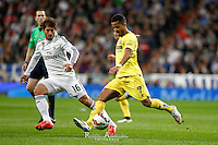 Villareal´s Mexican forward Giovani Dos Santos and Real Madrid´s Lucas Silva