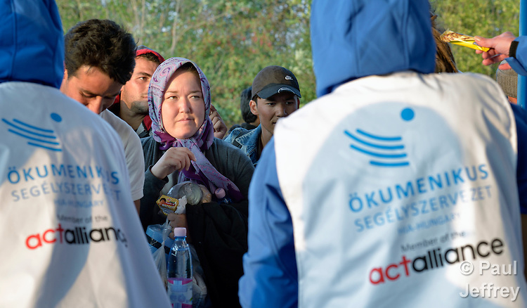 Refugees and migrants receive food and blankets from Hungarian Interchurch Aid, a member of the ACT Alliance, as they leave the Hungarian town of Hegyeshalom and prepare to cross the border into Austria. Hundreds of thousands of refugees and migrants flowed through Hungary in 2015, on their way to western Europe from Syria, Iraq and other countries.
