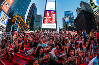 New York, NY - 11 July 2014 Tourists on the red TKTS Steps in Times Square ©Stacy Walsh Rosenstock/Alamy