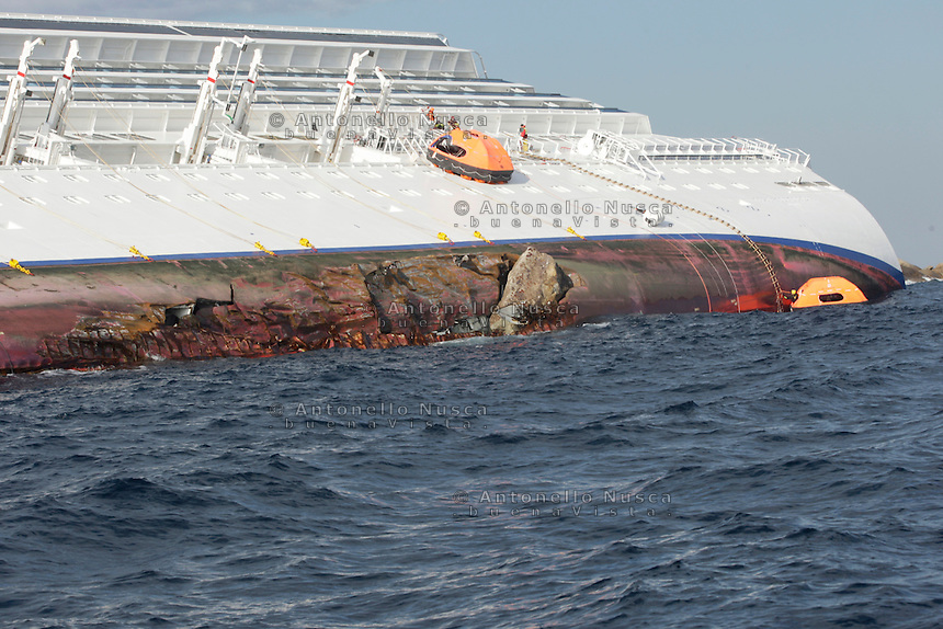 Island of Giglio, Italy, January 15, 2012. Firemen inspect the emerged side of the Costa Concordia ship in front of the Isola del Giglio harbour..(Antonello Nusca/ Casilli/Pool)