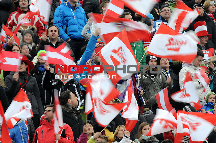 Innsbruck, Austria 04.01.2014 <br /> 2013-14 Vierschanzentournee, <br /> FIS Ski Jumping World Cup <br /> The Austrian locan fans celebrating during the FIS Ski Jumping World Cup Vierschanzentournee on January 4, 2014 in Innsbruck, Austria.<br /> Foto &copy; nph / Pier Paolo Piciucco