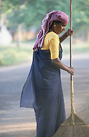 A woman street sweeper in Cochin.