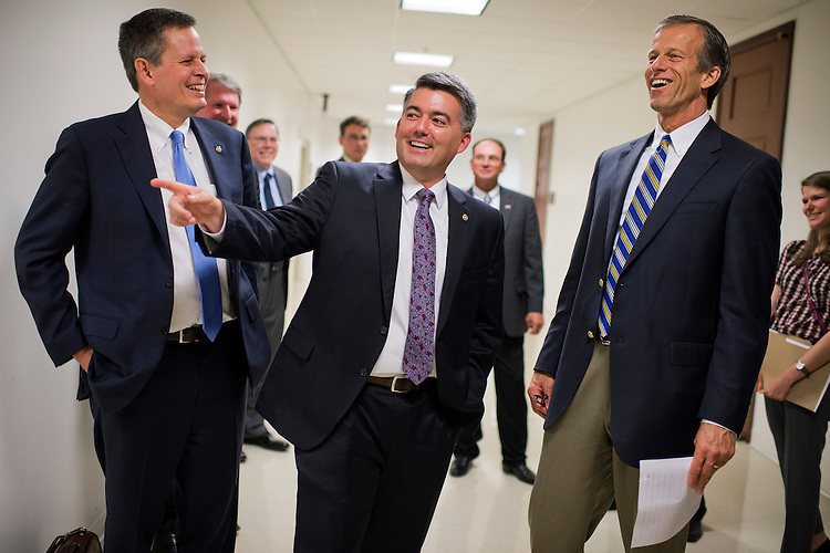 UNITED STATES - MAY 14: From left, Sens. Steve Daines, R-Mont., Cory Gardner, R-Colo., and John Thune, R-S.D., prepare for news conference in the Capitol Visitor Center with agriculture leaders to urge passage of the trade promotion authority legislation, May 14, 2015. (Photo By Tom Williams/CQ Roll Call)