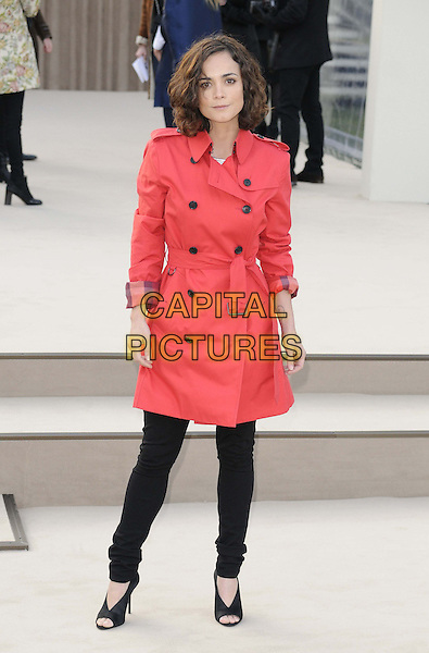 Alice Braga.attended the Burberry Prorsum London Fashion Week a/w 2013 catwalk show, Kensington Gardens, Hyde Park, London, England..February 18th, 2013.LFW full length red jacket black trousers open toe shoes trenchcoat mac .CAP/CAN.©Can Nguyen/Capital Pictures.