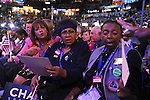 Illinois delegates react negatively to a petition circulated in support of Hillary Clinton on the floor at the Democratic National Convention at the Pepsi Center in Denver, Colorado on August 25, 2008.