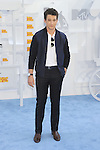 LOS ANGELES, CA - APRIL 12: Actor Miles Teller arrives at the 2015 MTV Movie Awards at Nokia Theatre L.A. Live on April 12, 2015 in Los Angeles, California.