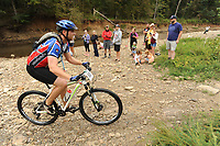 NWA Democrat-Gazette/ANDY SHUPE<br /> Riders make their way across Lee Creek Saturday, Sept. 19, 2015, during the Northwest Arkansas Mountain Bike Championships at Devil's Den State park.