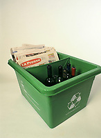 File Photo<br /> <br /> A Montreal city Recycle bin filled with newspaper and glass bottles<br /> <br /> <br /> Mandatory Credit: Photo by Pierre Roussel- Images Distribution. (&copy;) Copyright 2004 by Pierre Roussel <br /> <br /> NOTE : scan from 2 1/4 slide