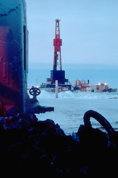 Alaska, Prudhoe Bay, Oilfields, oilfield pollution, Circa 1978 Parker 141 drilling rig and waste oil on ARCO side of North Slope,.