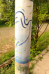 A light pole with a painted peace bird on a street in Suchitoto, El Salvador - a town ravaged by civil war in the 1980s.