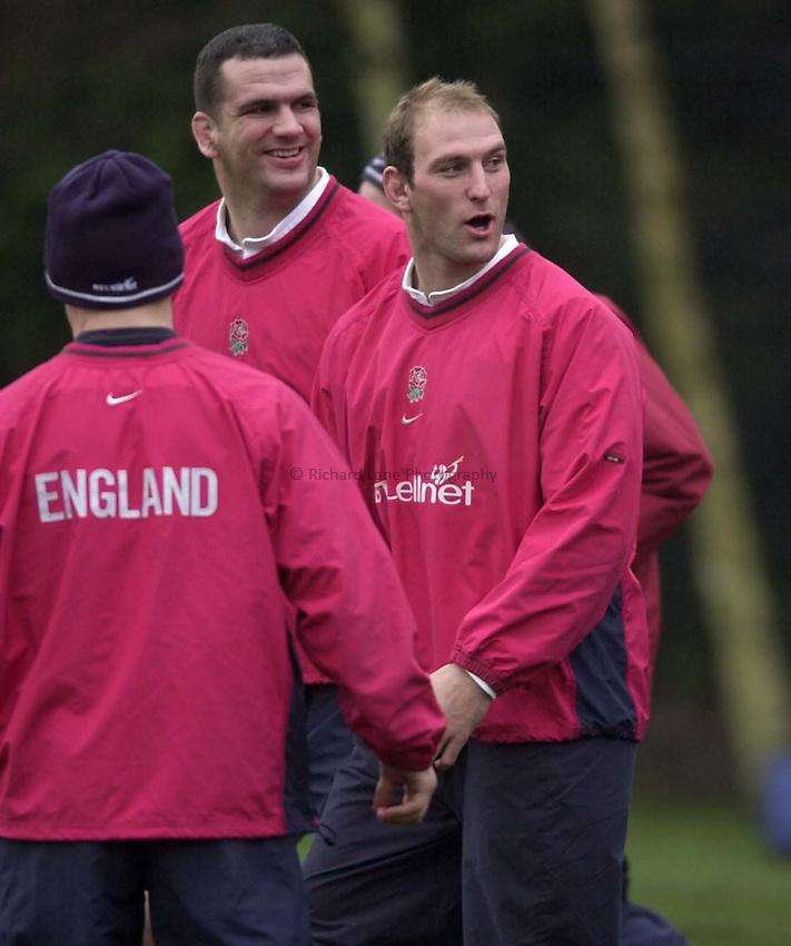 Photo. Richard Lane. .English Rugby Training, Sandhurst. 31-01-2001..Lawrence Dallaglio and Martin Johnson joke during training.