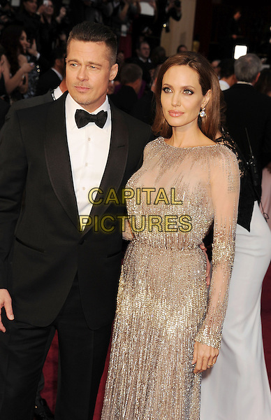 HOLLYWOOD, CA- MARCH 02: Actors Brad Pitt (L) and Angelina Jolie attend the 86th Annual Academy Awards held at Hollywood &amp; Highland Center on March 2, 2014 in Hollywood, California.<br /> CAP/ROT/TM<br /> &copy;Tony Michaels/Roth Stock/Capital Pictures