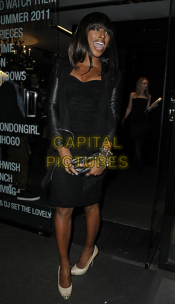 ALEXANDRA BURKE.The Dress Me Up party, Dolce & Gabbana boutique, Old Bond St., London, England..March 31st, 2011.full length black dress leather jacket beige shoes mouth open clutch bag.CAP/CAN.©Can Nguyen/Capital Pictures.