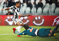 Calcio, Serie A: Juventus - Genoa, Torino, Allianz Stadium, 22 gennaio 2018. <br /> Juventus' Douglas Costa (l) scores contrasted by Genoa's goalkeeper Mattia Perin (r) during the Italian Serie A football match between Juventus and Genoa at Torino's Allianz stadium, January 22, 2018.<br /> UPDATE IMAGES PRESS/Isabella Bonotto